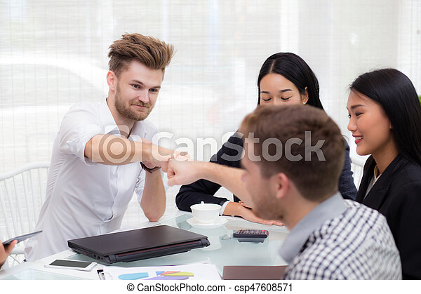 businessman giving fist bump after business achievement in meeting room - teamwork concept. - csp47608571