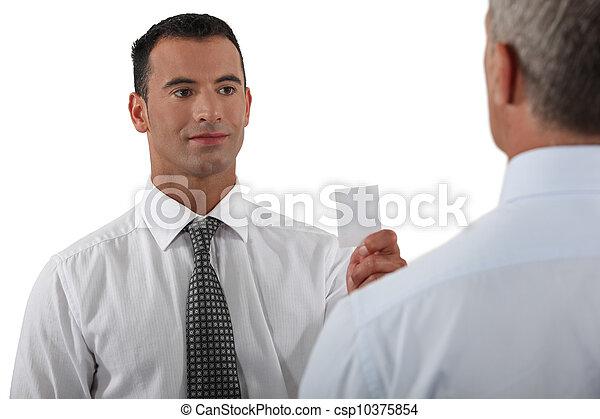 businessman giving his card - csp10375854