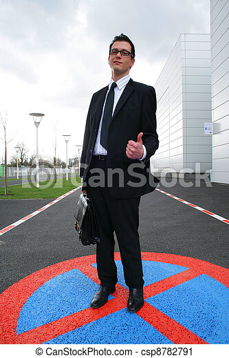 Businessman giving the thumb's up in a parking lot - csp8782791