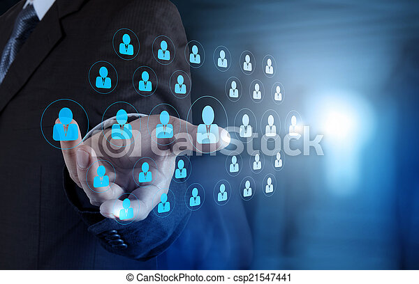 businessman hand choosing people icon as human resources concept - csp21547441