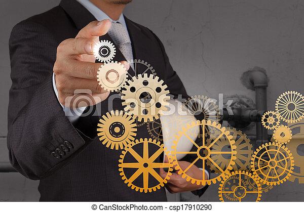 businessman hand draws gear to success  - csp17910290