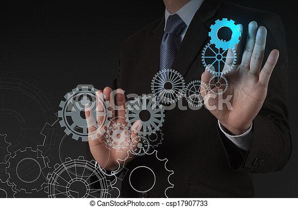 businessman hand draws gear to success  - csp17907733