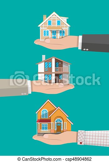 Businessman hand holding house. Real estate - csp48904862