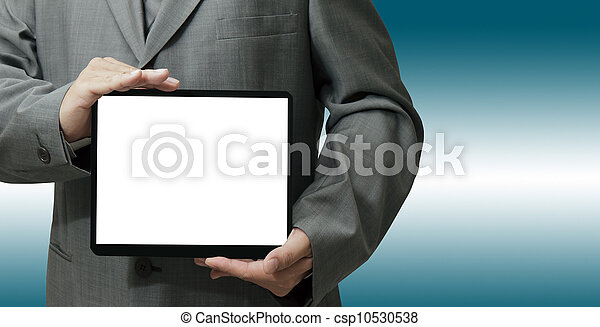 businessman hand holds and touch tablet computer  - csp10530538