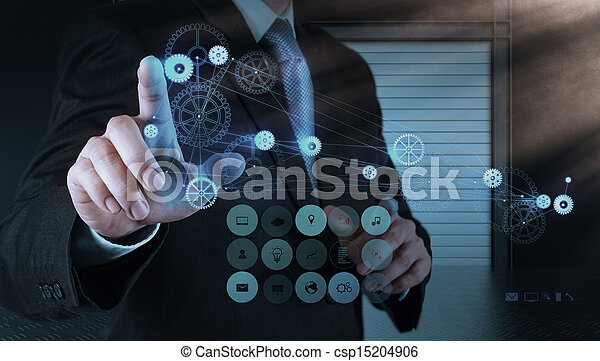 businessman hand pointing to the  gear to success - csp15204906