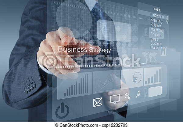 businessman hand points to business strategy  - csp12232703