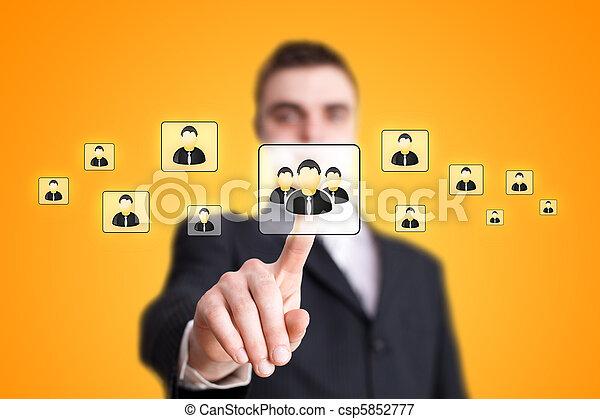 Businessman hand pressing Social network icon 2 - csp5852777