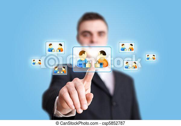 Businessman hand pressing Social network icon 2 - csp5852787