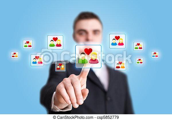 Businessman hand pressing Social network icon 2 - csp5852779