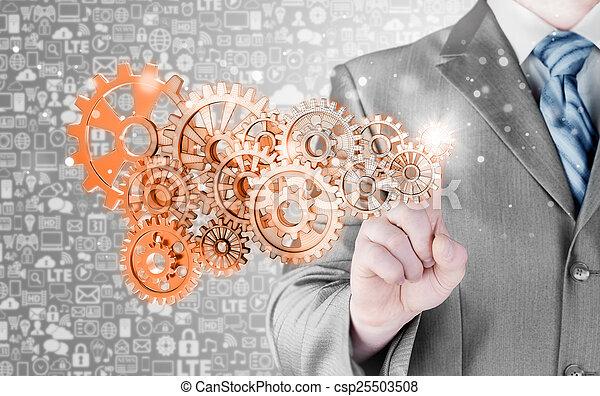 businessman hand touch  gear to success concept - csp25503508