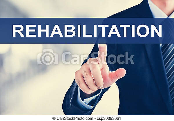 Businessman hand touching REHABILITATION word on virtual screen - csp30893661