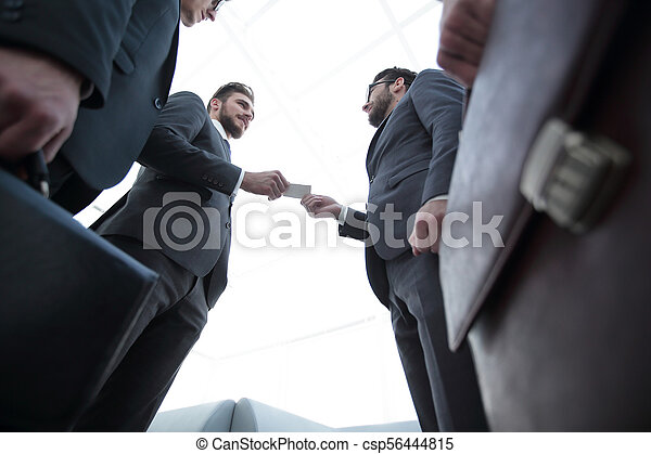 businessman handing business card to the partner. - csp56444815