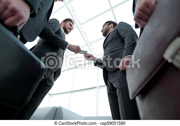 businessman handing business card to the partner. - csp59051580