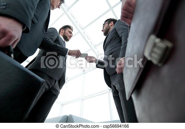 businessman handing business card to the partner. - csp56694166