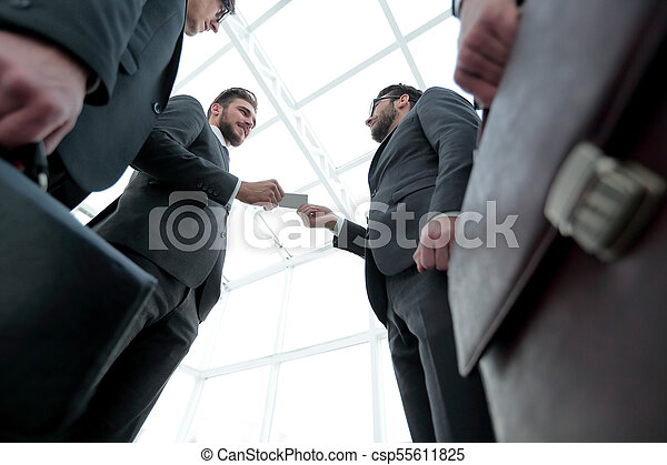 businessman handing business card to the partner. - csp55611825