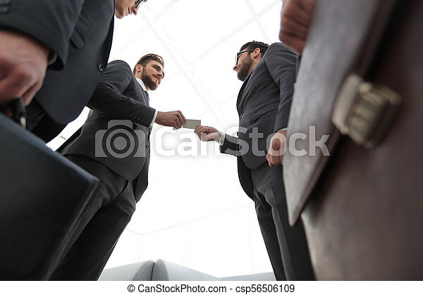 businessman handing business card to the partner. - csp56506109