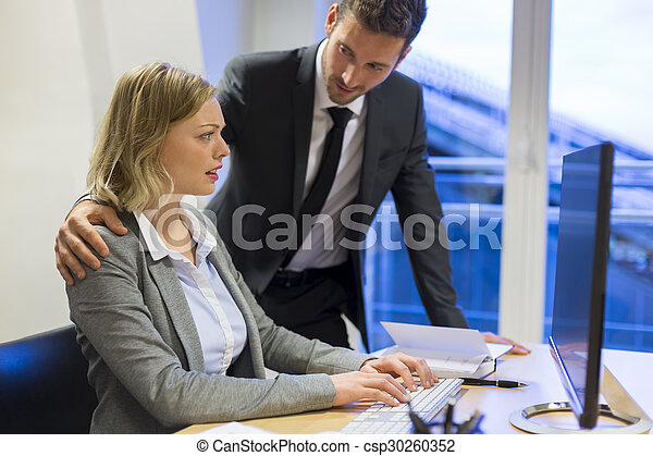 Businessman harassing his colleague at work - csp30260352