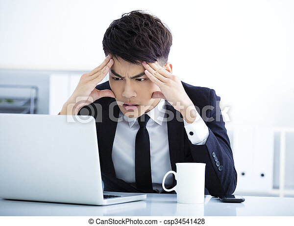 Businessman having stress in the office   - csp34541428