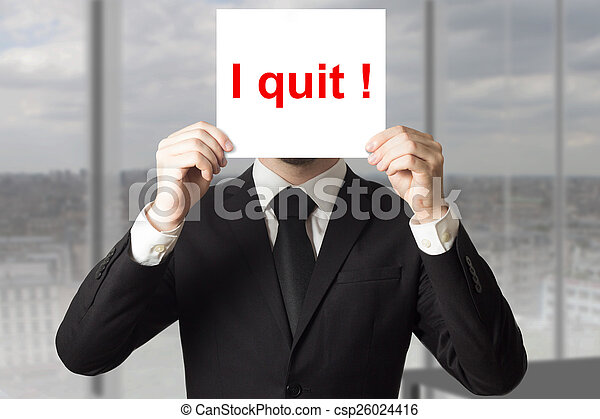 businessman hiding face behind sign i quit - csp26024416