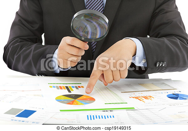 businessman hold a magnifying glass to check - csp19149315