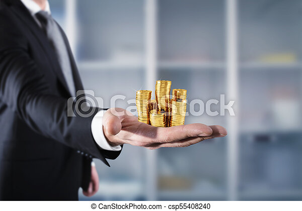 Businessman hold piles of money. Concept of success and company growth - csp55408240
