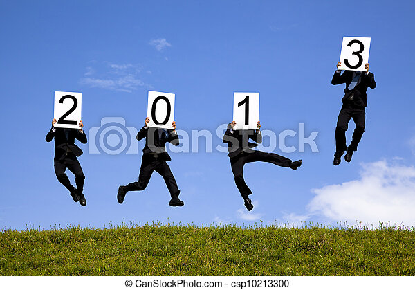businessman holding 2013  and jumping on the green field - csp10213300
