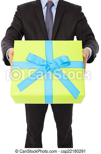 Businessman holding a gift. isolated on white background - csp22180291