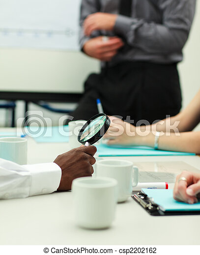 Businessman holding a magnifying glass  - csp2202162