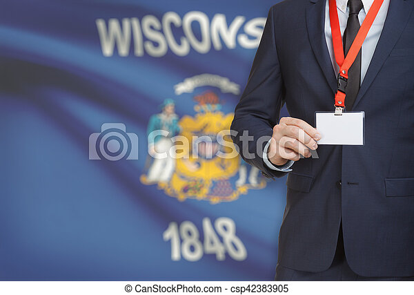 Businessman holding badge on a lanyard with USA state flag on background - Wisconsin - csp42383905