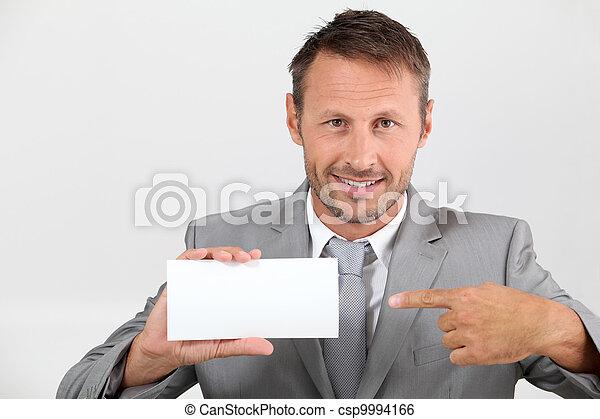 Businessman holding business card - csp9994166
