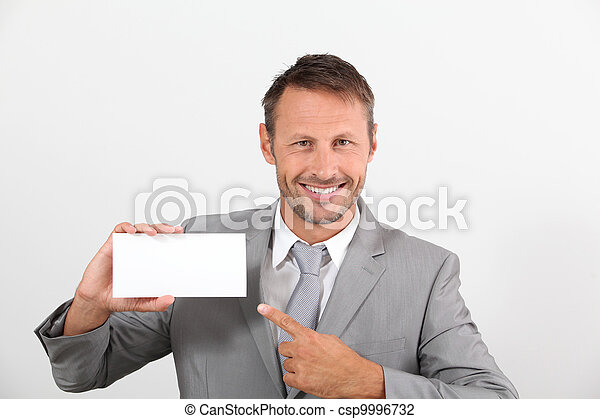 Businessman holding business card - csp9996732