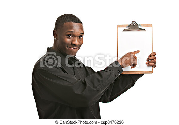 Businessman holding clipboard smiling isolated - csp8476236