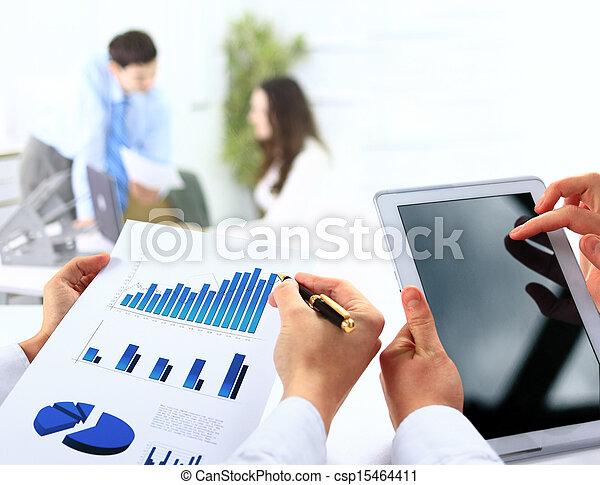 businessman holding digital tablet in office - csp15464411