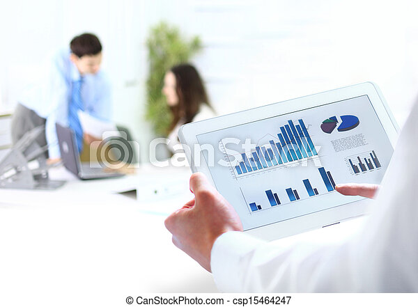 businessman holding digital tablet in office - csp15464247