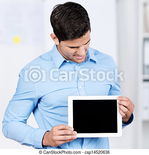 Businessman Holding Digital Tablet While Looking At It - csp14520636