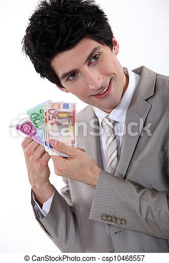 Businessman holding Euro bank notes - csp10468557