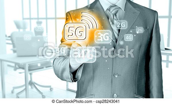 businessman holding in hand 5G, technology background - csp28243041