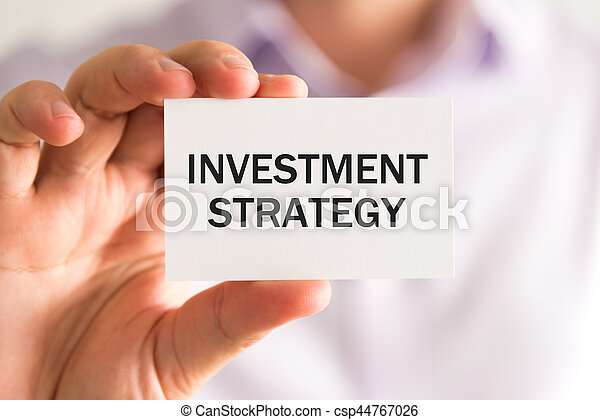 Businessman holding INVESTMENT STRATEGY card - csp44767026