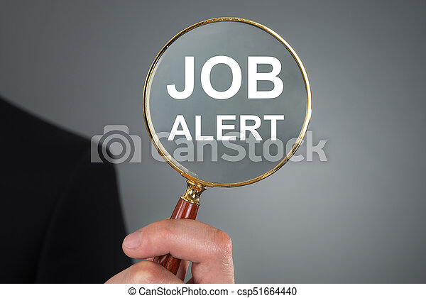 Businessman Holding Magnifying Glass - csp51664440