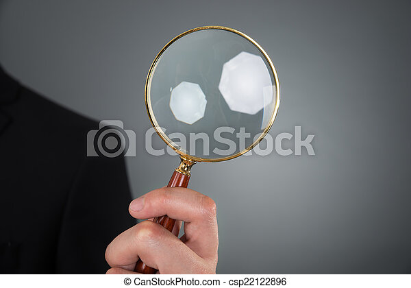 Businessman Holding Magnifying Glass - csp22122896