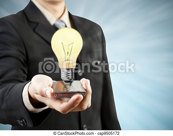 Businessman holding mobile phone light bulb coming out  technology, and new ideas concept - csp9505172