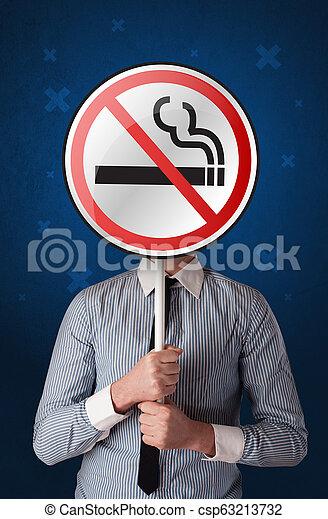 Businessman holding no smoking sign - csp63213732