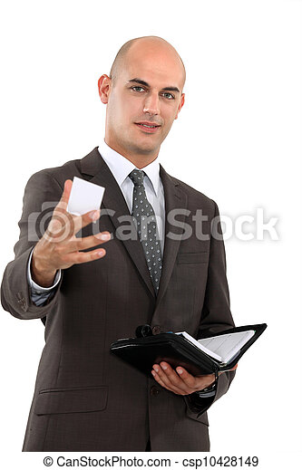 Businessman holding out his business card - csp10428149