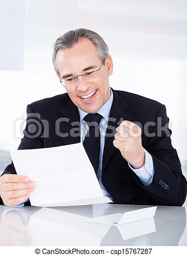 Businessman Holding Paper - csp15767287