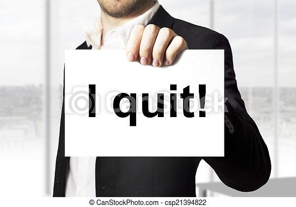 businessman holding sign i quit - csp21394822