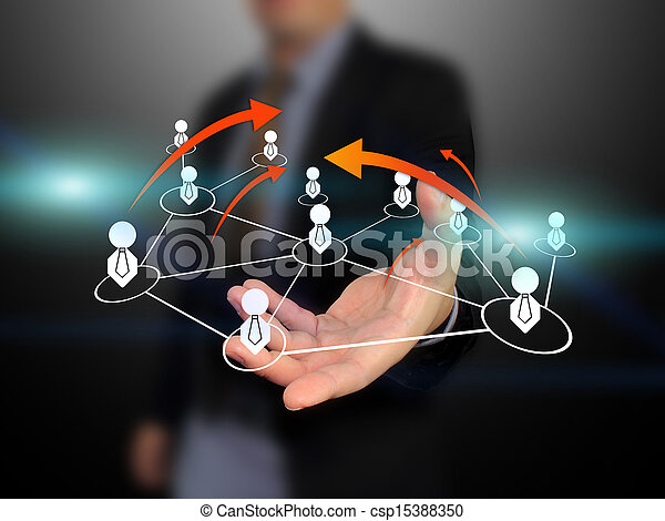 Businessman holding social network - csp15388350