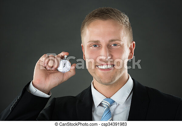 Businessman Holding Stopwatch In His Hand - csp34391983