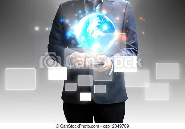 Businessman holding touchscreen - csp12049709