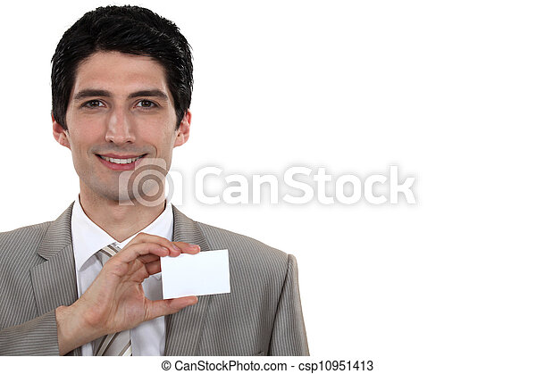 Businessman holding up his business card - csp10951413
