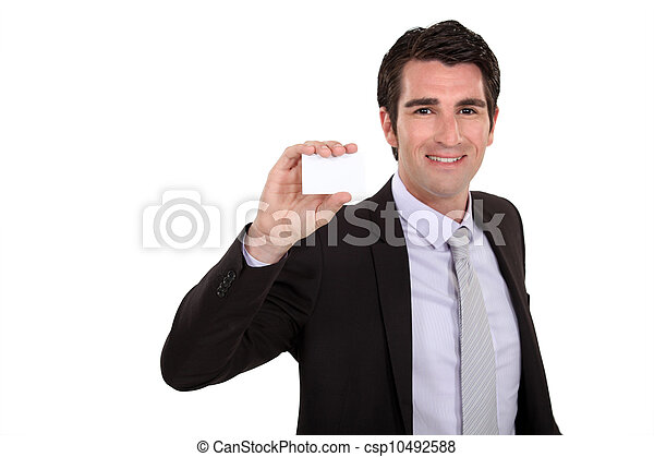 Businessman holding up his business card - csp10492588